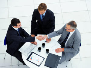 High-angle-view-of-business-people-discussing-in-a-meeting-000005327708_Large